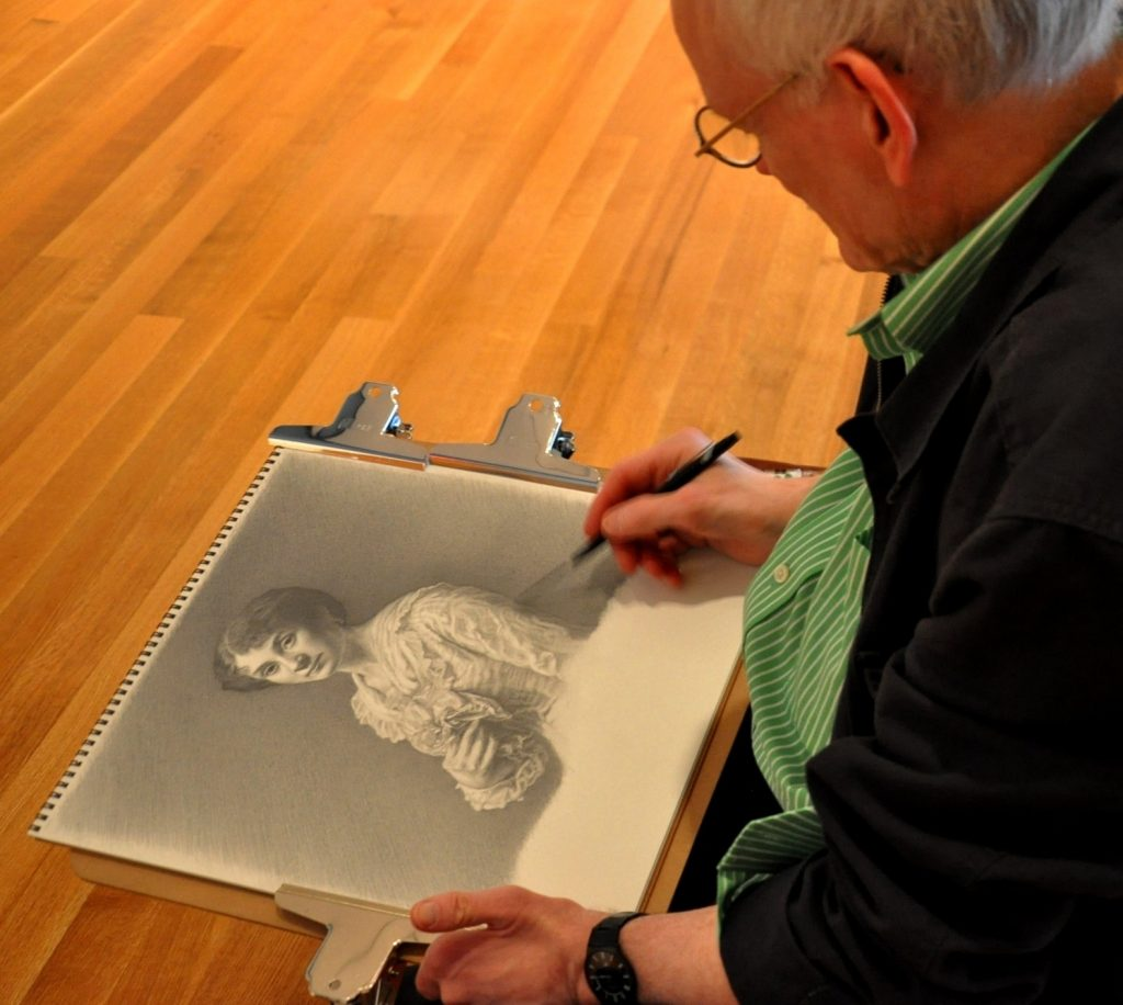 Photo of CWRU professor Ron Wilson drawing at the Cleveland Museum of Art