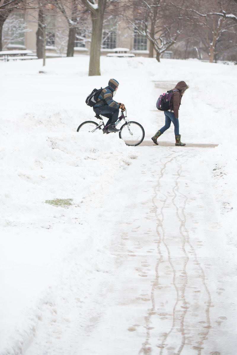 CWRU students biking and walking to class in winter
