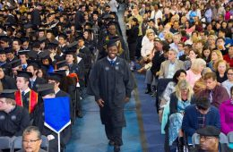 Graduates walking down the aisle at commencement ceremony