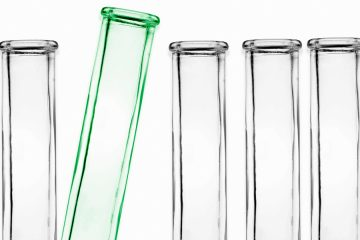 five test tubes on white background