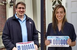 Andrew Getsy and Rachel Katz holding Ohio license plates