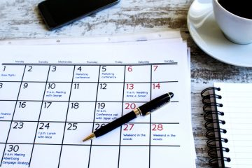 Calendar with a pen and coffee cup
