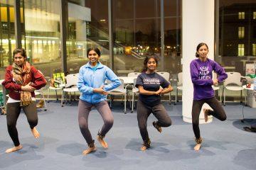 CWRU female students having dance practice inside Tinkham Veale University Center