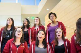 CWRU female students singing on the steps of Tinkham Veale University Center