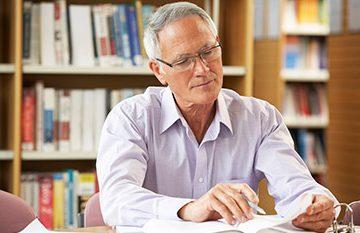 Older man studying