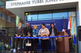 Individuals stand at the ribbon cutting ceremony at Stephanie Tubbs Jones Hall at CWRU
