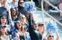 CWRU students cheering on the Spartans from the stands at Homecoming football game