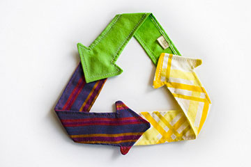 Recycle logo made out of fabric arrows