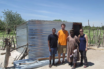 Students pose with family from Namibia