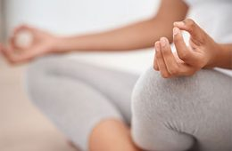 Close-up on hand of woman in yoga meditation pose
