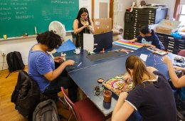 Students working on art projects at table