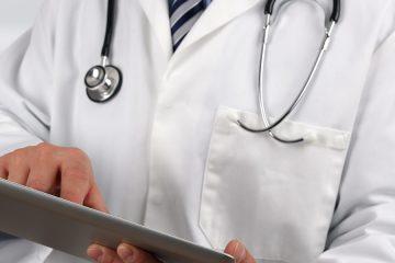 doctor holding digital device