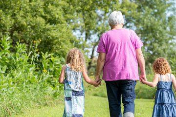 Grandmother walking with children