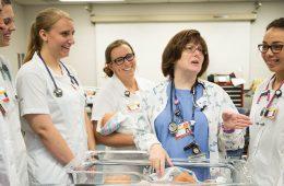 Nursing students gather around instructor