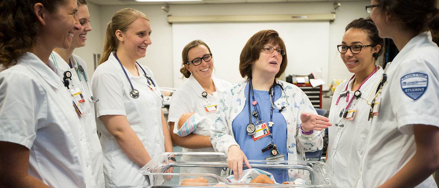 Nursing students gather around instructor