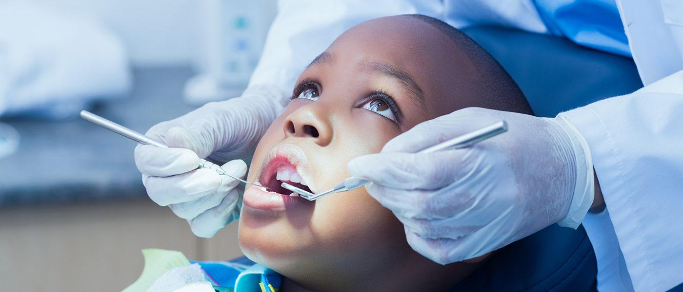 Child gets a dental exam