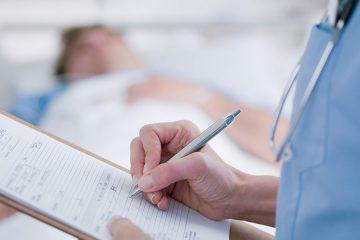 Nurse checking patient chart