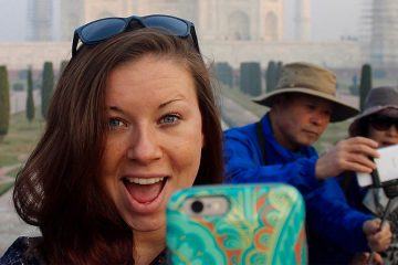 Student takes selfie in front of the Taj Mahal