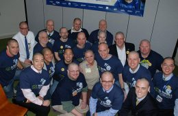"Members of ""Team Rainbow"" pose for group photo after their heads have been shaved"