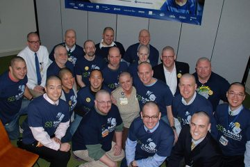 """Members of """"Team Rainbow"""" pose for group photo after their heads have been shaved"""