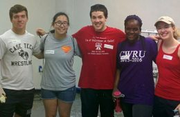 Gabriella Kaddu and four other students pose for photo while volunteering.