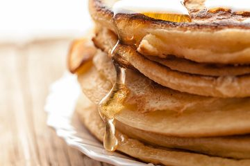 Pancakes with syrup on a plate.