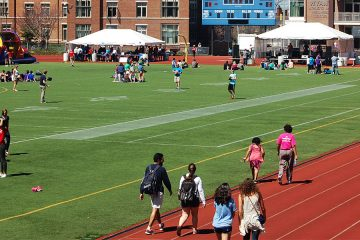 People walk around the track at Relay for Life event