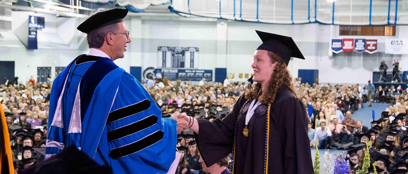 Student receives diploma during commencement 2017 ceremony