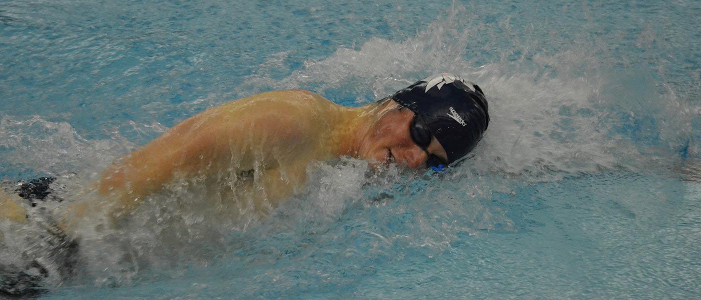 Photo of Andrew Henning swimming