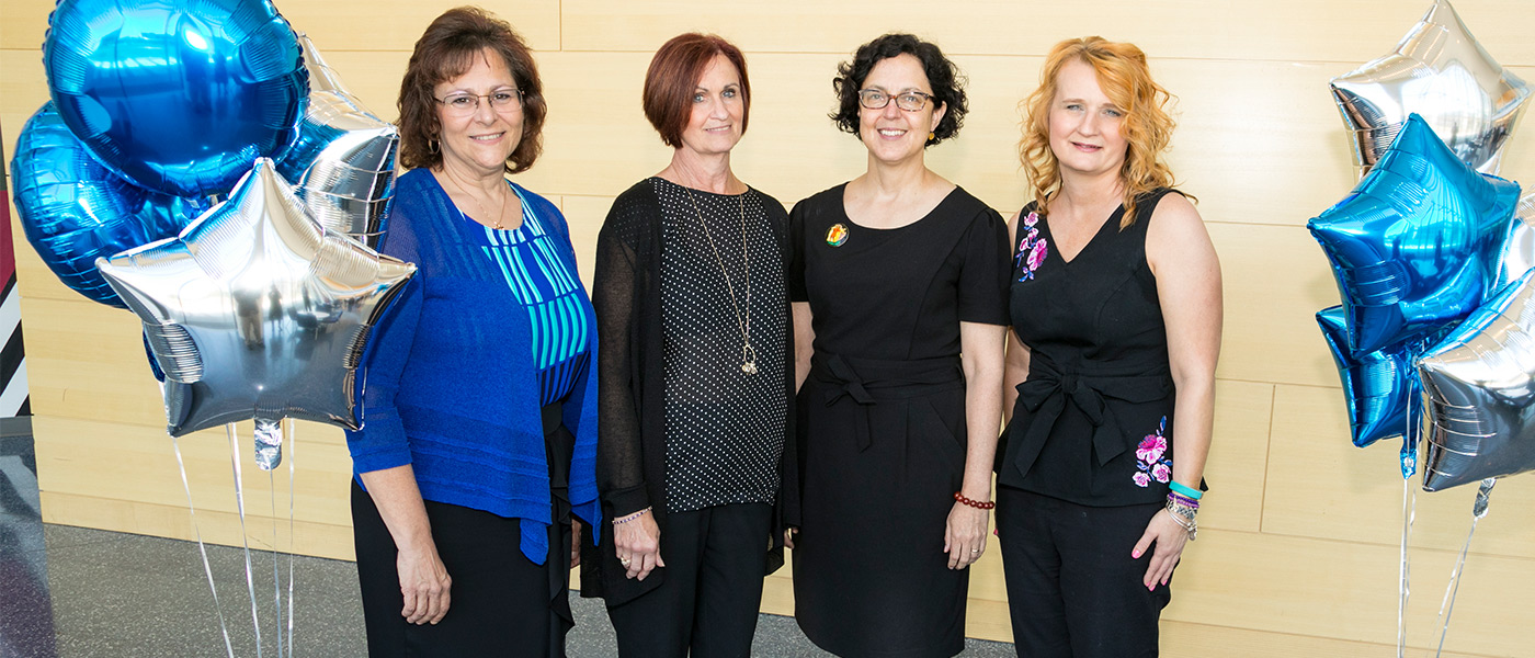 Group photo of Debra Bush, Susette Ziats, Elizabeth Woyczynski and Kori Kosek