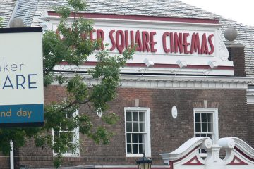 "Photo of Shaker Square Cinemas with ""Shaker Square"" sign in foreground"