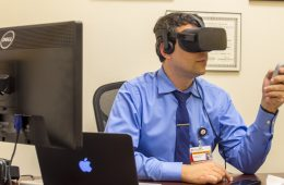 Renato Roperto wearing a virtual reality headset