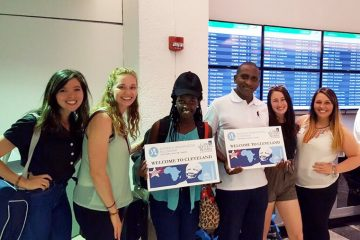 Chrissy Corrigan, Kelly Schmidt, Hillary Lacks and and Alyssa Wigal with two of the Young African Leaders Initiative fellows