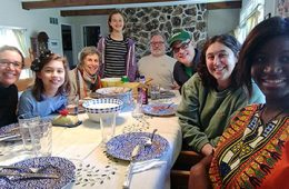 Lisa Kollins and Kayele Silue with Kollins' family sitting around a table