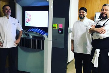 Bon Appetit Management Co. chefs stand beside new pizza ATM in Sears think[box]