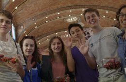 First-year students wave at the camera while at the West Side Market