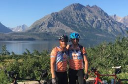 Tony Damiano and Eric Eldred pose for photo in front of mountain