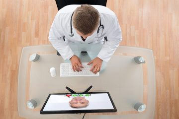 Doctor meeting with patient via videoconference
