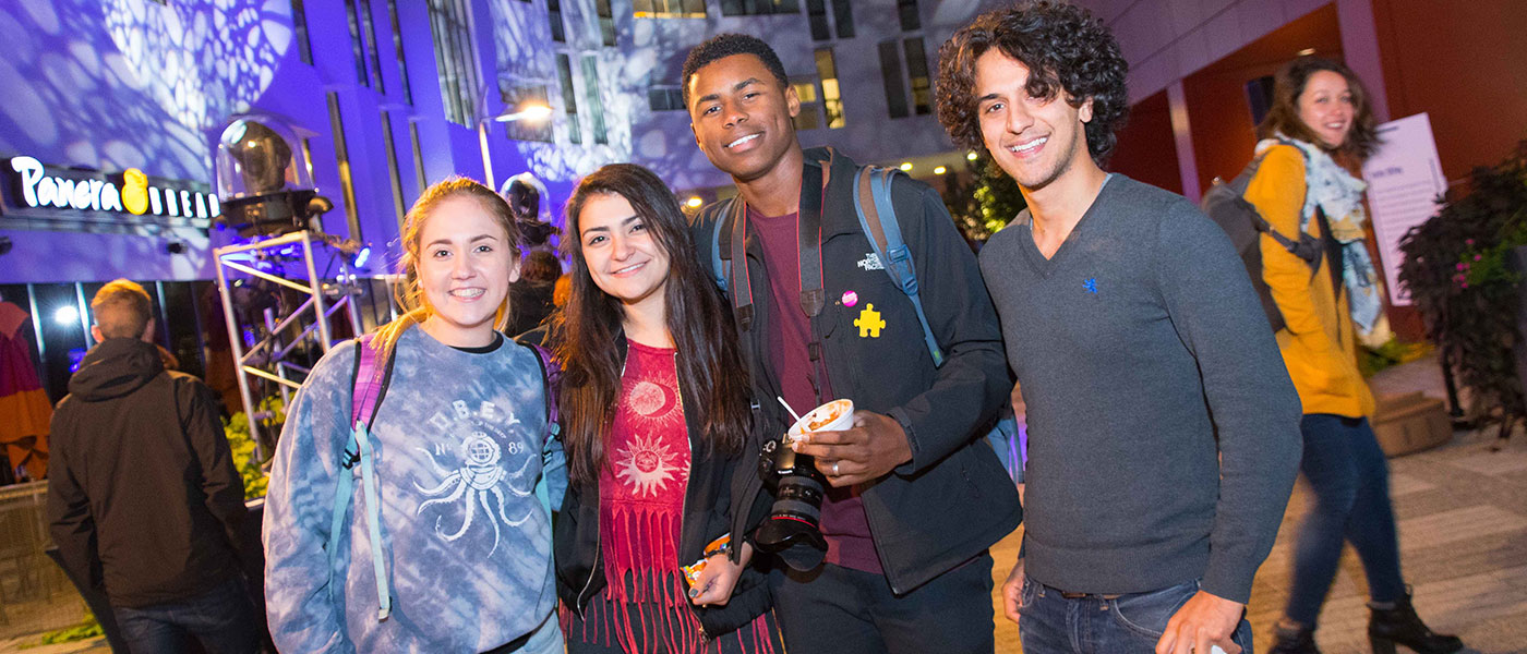 Students pose for photo at Blue Block Party
