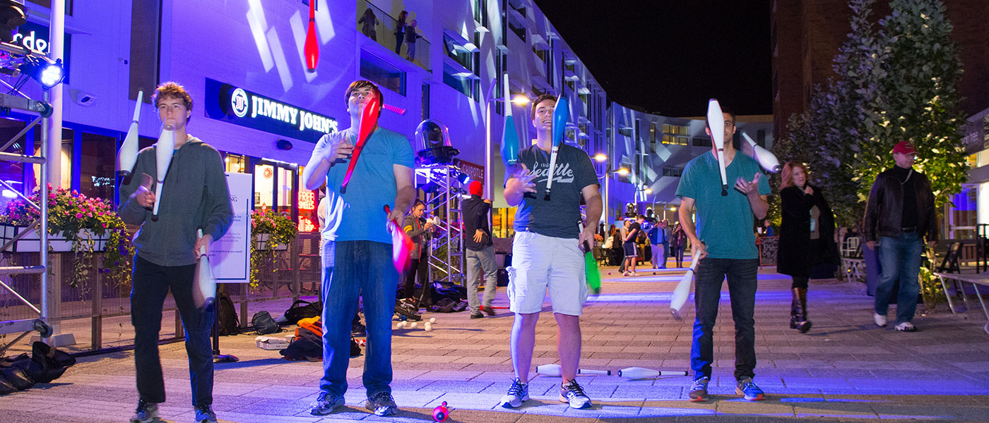 Photo of four students juggling at Blue Block Party