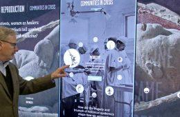 Museum curator demonstrates digital wall.