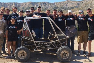The CWRU Motorsports team poses for photo with their vehicle