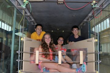 Four students pose for photo together while working on a resarch project in China