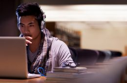 student studying on computer in library
