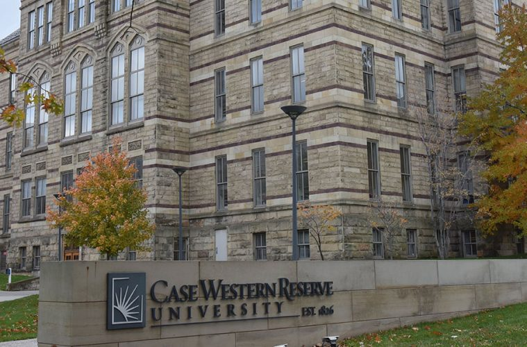 CWRU signage outside of Adelbert Hall in fall