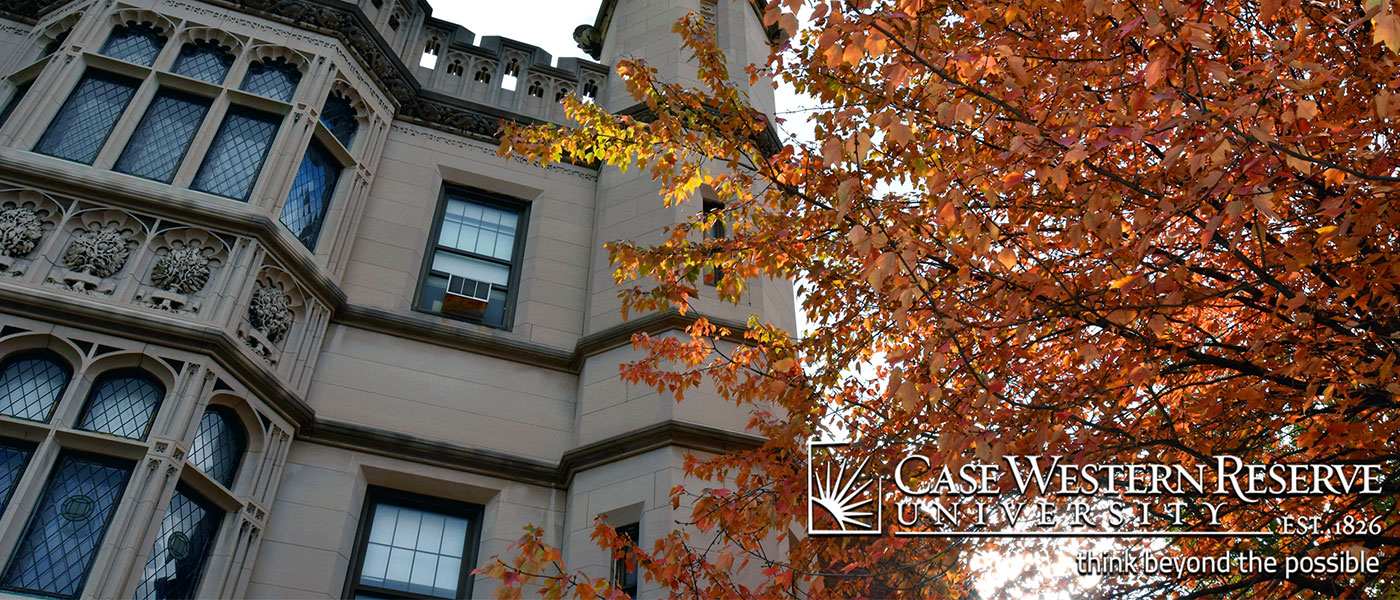 Cropped version of a fall-themed CWRU computer screen background with photo of colorful tree and campus building with CWRU logo in corner