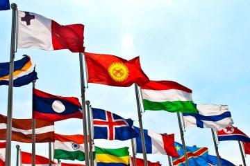 international flags waving against clue sky