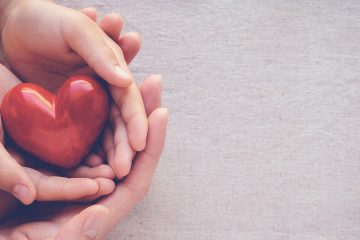 hands holding heart, charity