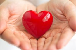 Photo of red heart in hands
