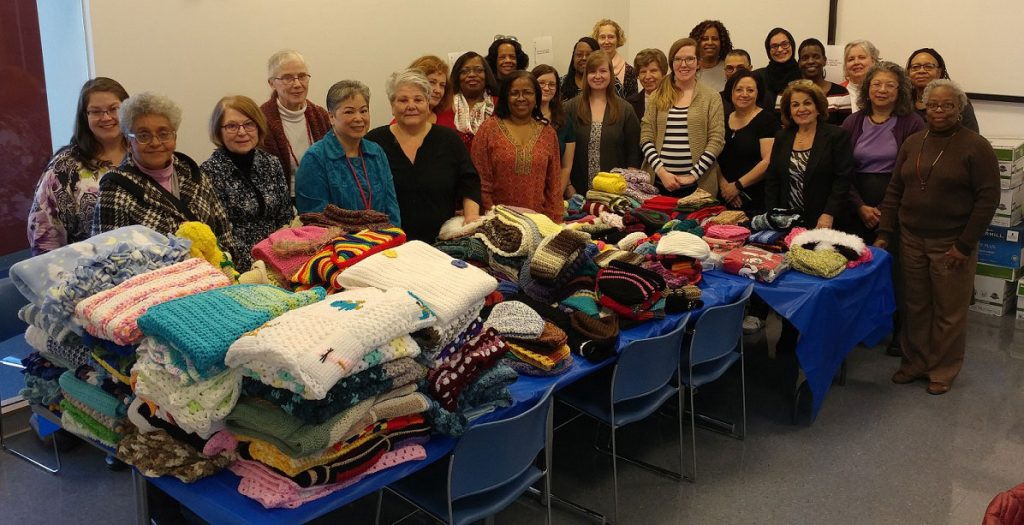 Members of the Crafters@Case group pose with items they made
